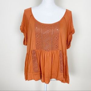 Free people orange embroidered swing top